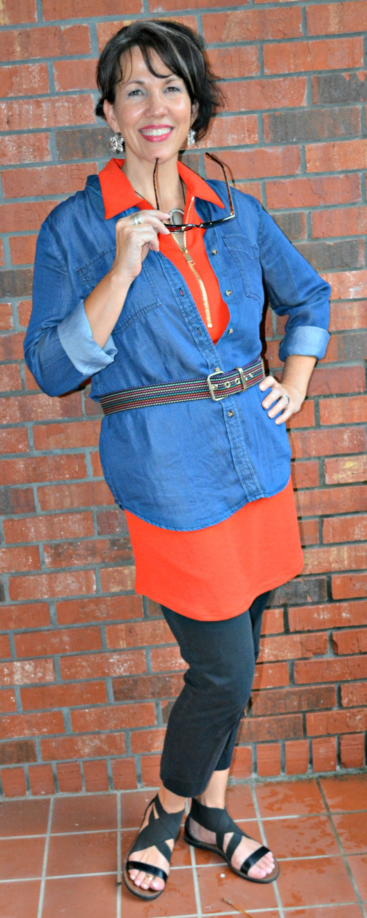 Shellie Bowdoin layers her Chambray shirt over an orange tunic
