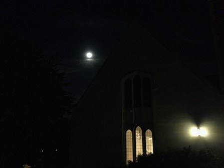 The Moon rises over Community Hall