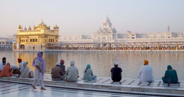The Golden temple Amritsar people sitting