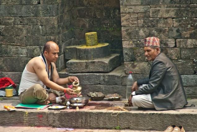 Puja ay Bagmati river behind Pashupatinath Temple Kathmandu Nepal