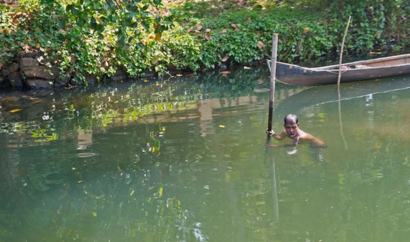 Man catching fish in Kerala Backwaters