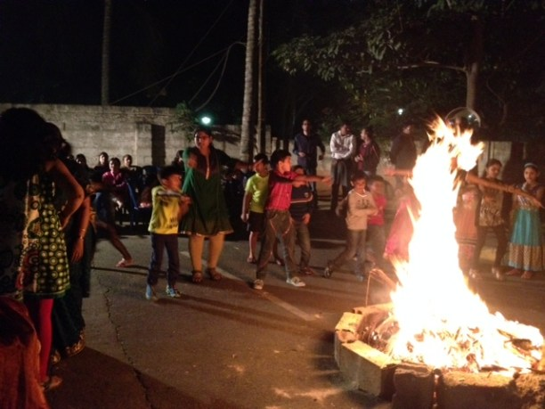 Children revelled in throwing popcorns and puffed rice into the fire and singing songs
