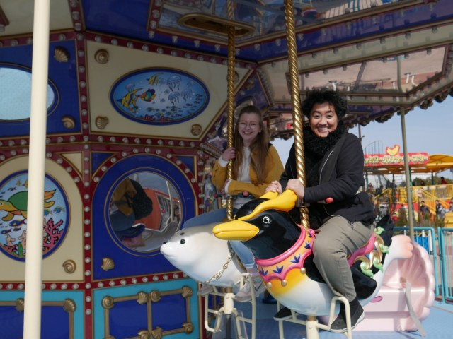 photo of two people sat on a carousel ride in Japan