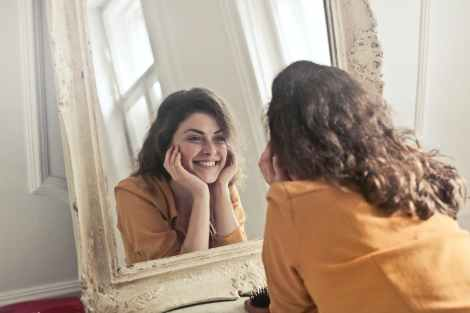 photo of woman looking at the mirror, ego work, self reflection