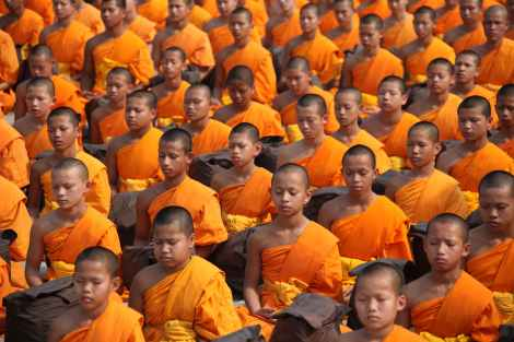 buddha taught vipassana meditation to his monks, monks sitting in deep meditation