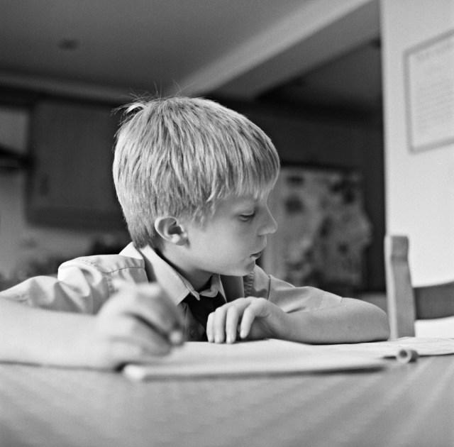 yashica mat lm tlr kodak tri-x b&w black white film analogue 120 portrait bot homework studying kitchen