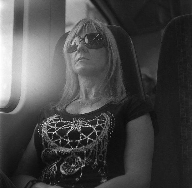 Yashica 44 TLR rerapan 100 127 format film b&w train carriage portrait woman sleeping lens flare