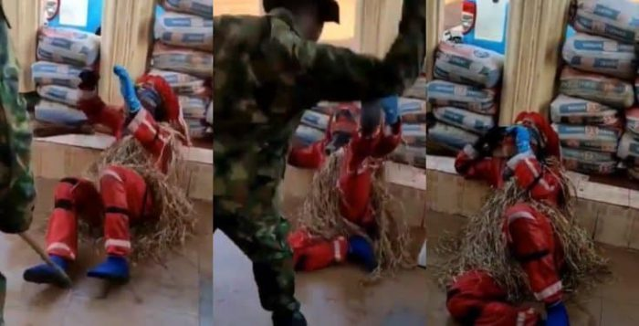 A Nigerian soldier has been caught on video flogging a masquerade mercilessly as he begged for mercy.