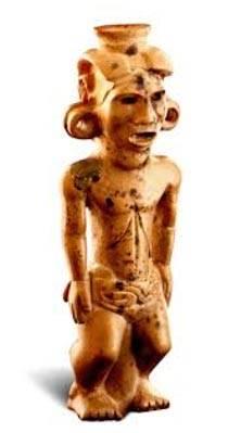 La pipa Adena. Su cabeza y su torso son grandes en comparación con sus piernas, sugiriendo para algunos que representa a un enano.