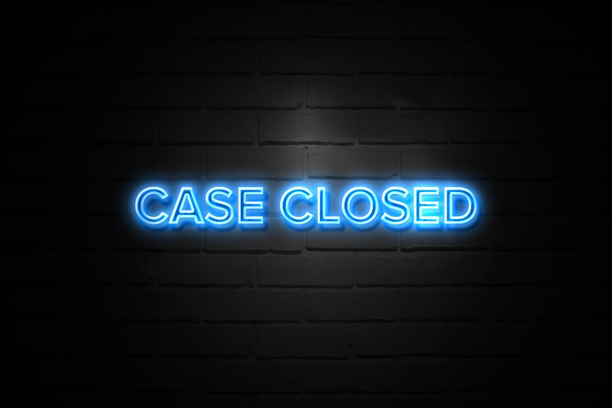 Case Closed neon Sign on brickwall
