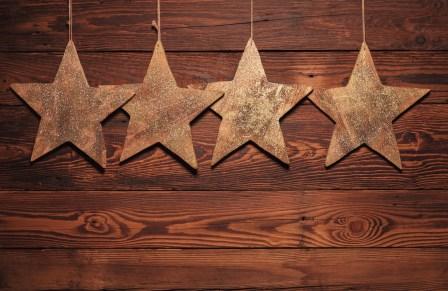 four wooden stars for christmas