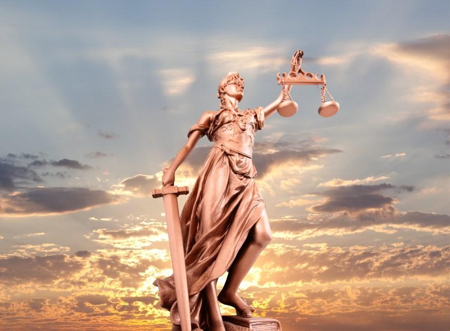 Justice lady statue at sunrise image.jpeg