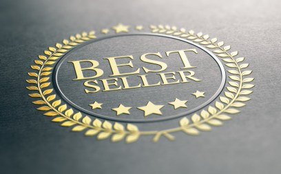 Golden Best Seller Award Over Black Paper Background