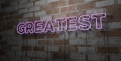 GREATEST - Glowing Neon Sign on stonework wall