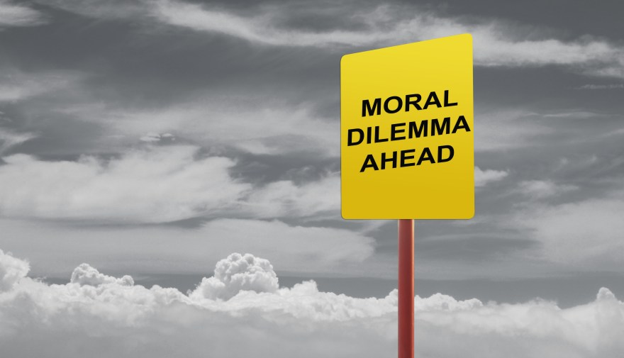 Moral dilemma ahead signage