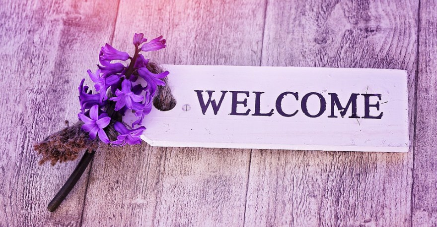 Welcome purple background with flower image