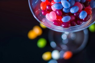selective focus photography of jelly beans on jar