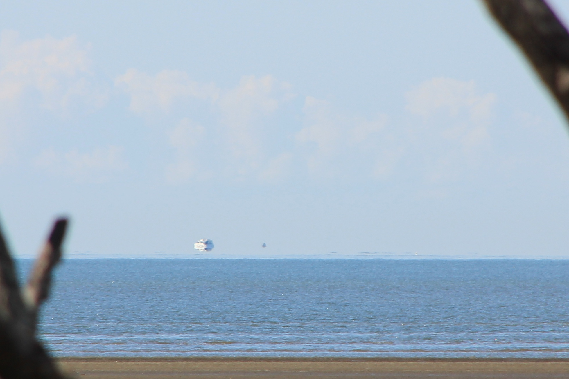 Ship appears to be hovering above sea. Courtesy Wikimedia.org by Timpaanen