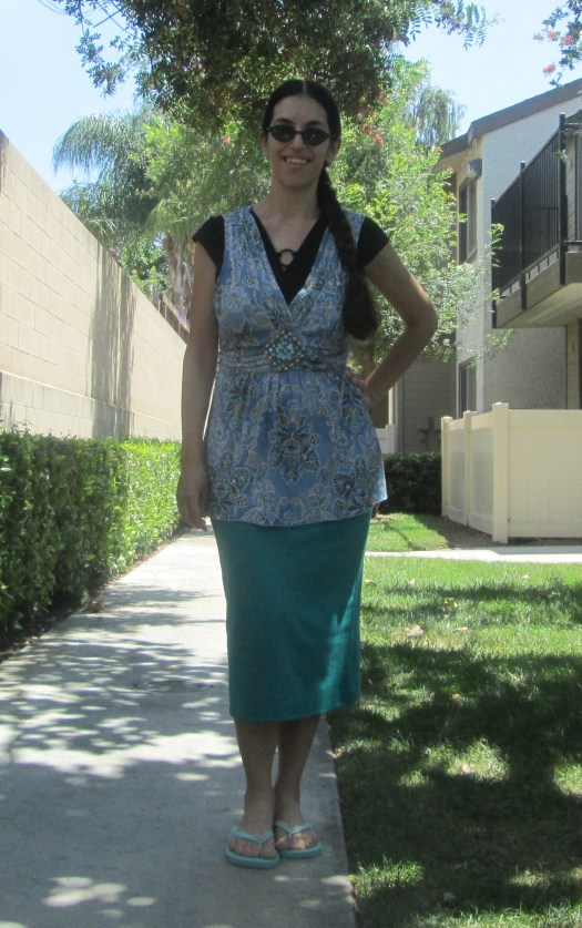 Wearing a jade pencil skirt with a flowy floral top.