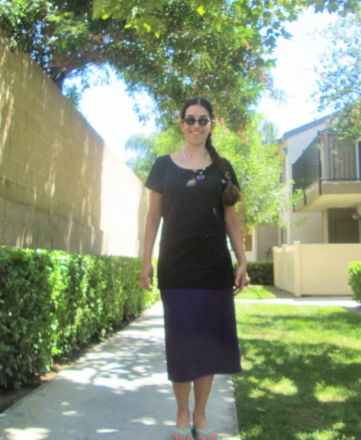 Wearing the purple pencil skirt with a black top.