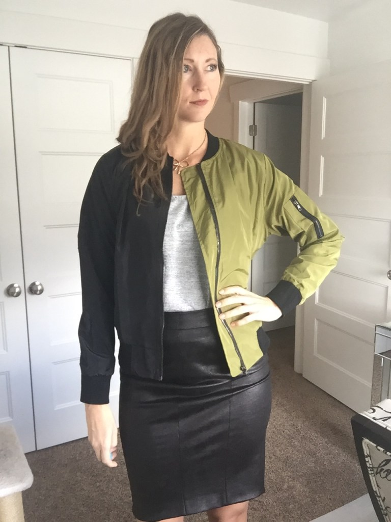 Olive green windbreaker jacket and faux leather pencil skirt