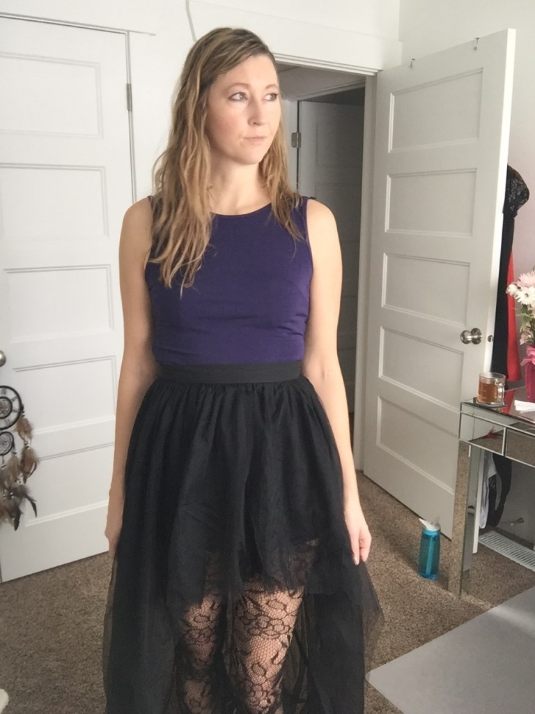 Black hi-low tulle skirt and printed tights