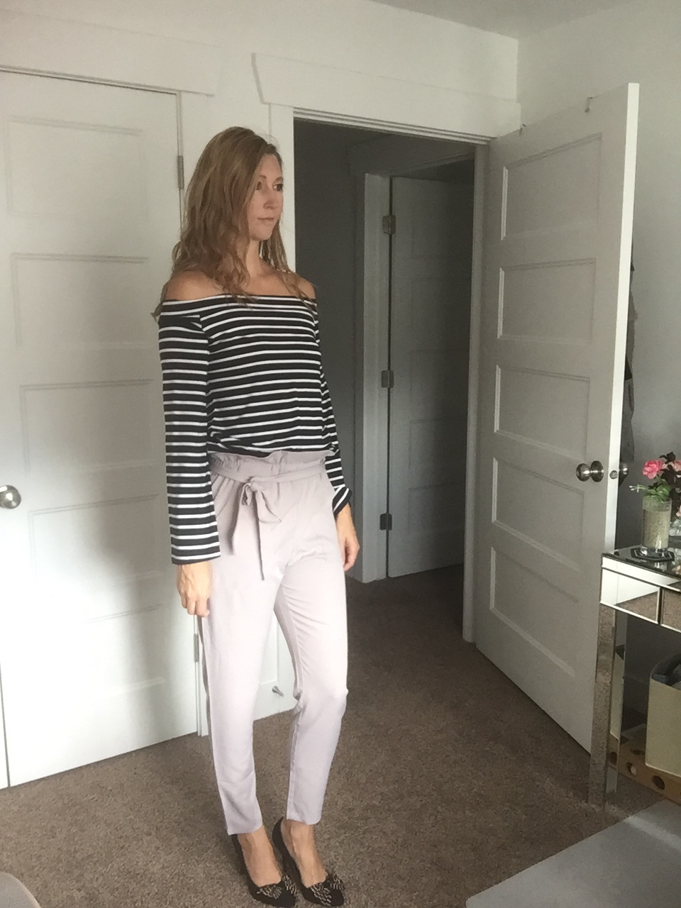 Beige Crop Trousers and Black and White Striped Top