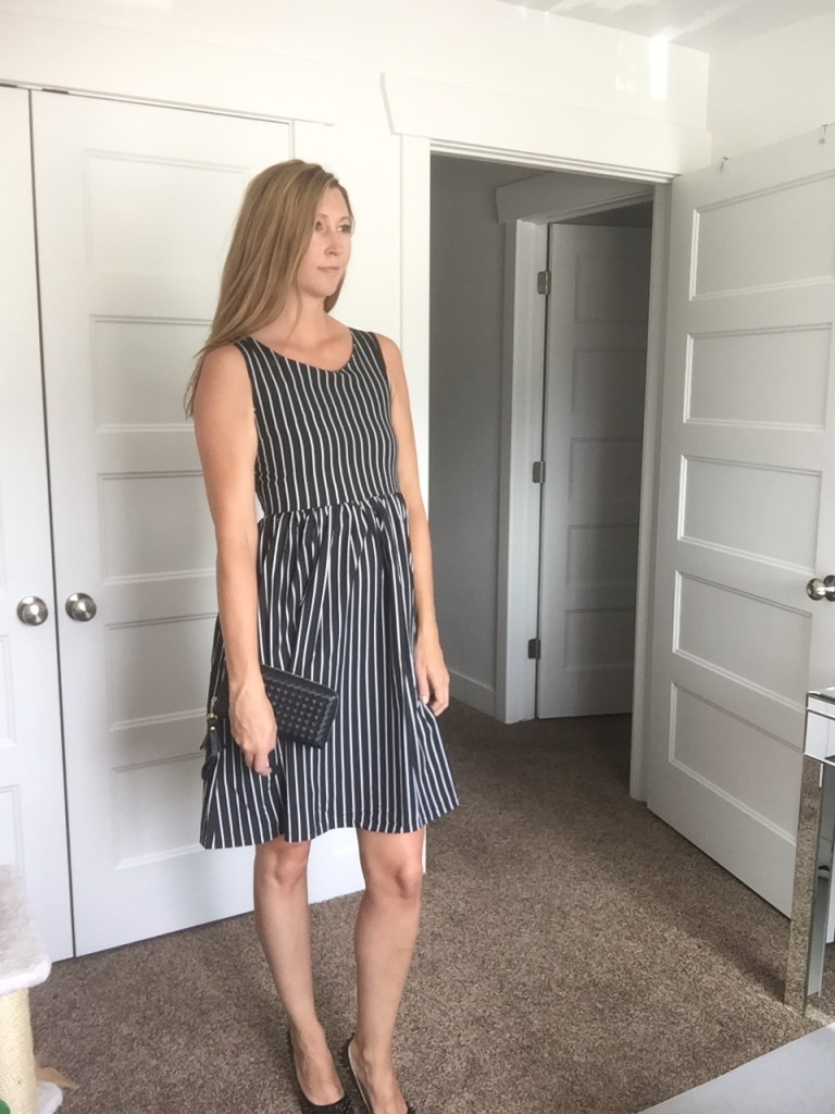 woman in Black and White Striped Sleeveless Dress