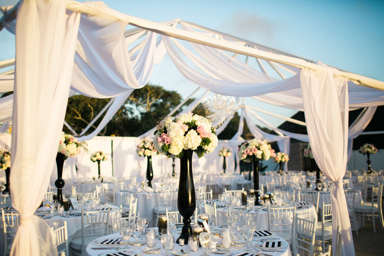 Wedding reception white and black accents with tall floral centerpieces. | More on: http://mysweetengagement.com/alexandra-and-matt-a-californian-proposal/ - SisterLee Photography