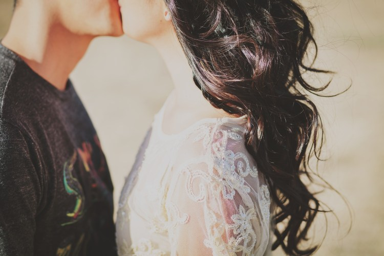 couple on engagement session photo giving a passionate kiss