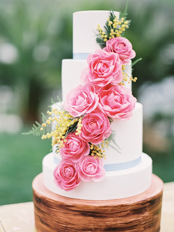 White wedding cake with beautiful cascading pink flowers | See more: http://mysweetengagement.com/15-extraordinary-wedding-cakes-for-all-wedding-styles