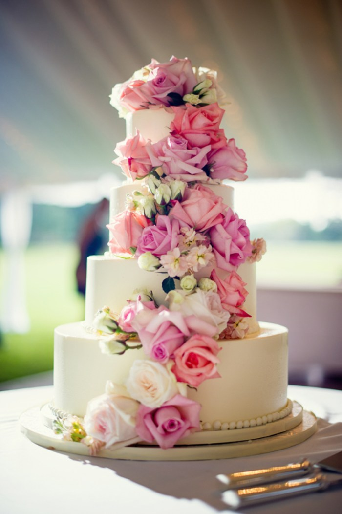 White wedding cake with piink shades of flowers in cascade style | See more: http://mysweetengagement.com/15-extraordinary-wedding-cakes-for-all-wedding-styles