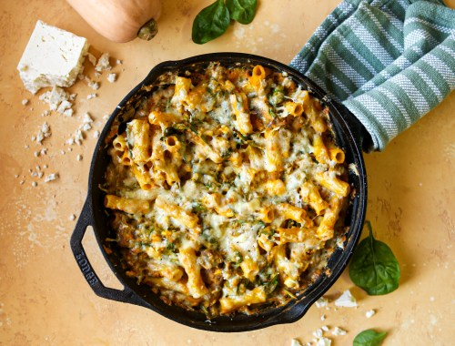 Spinach artichoke and feta baked rigatoni with Italian sausage and a butternut squash sauce | baked pasta | comfort food | squash recipe | main dish | one pan meal | cast iron pan |
