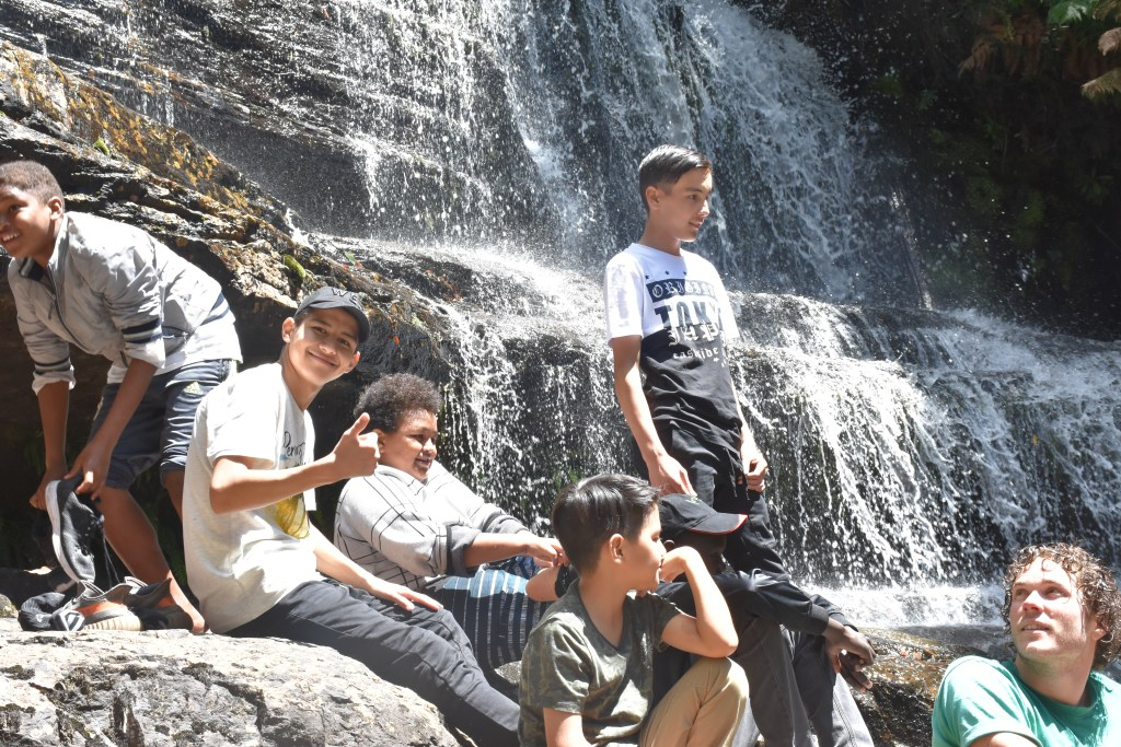 Picture of Youth clients at a waterfall
