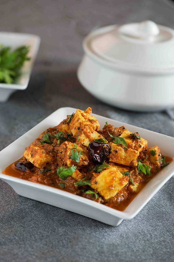 Achari paneer curry recipe that is tangy and has a zesty flavours from achari masala or Indian pickling spices. This a no onion no garlic paneer curry recipe with very flavourful and creamy gravy. This aromatic paneer curry that is served with Chapati rice or paratha