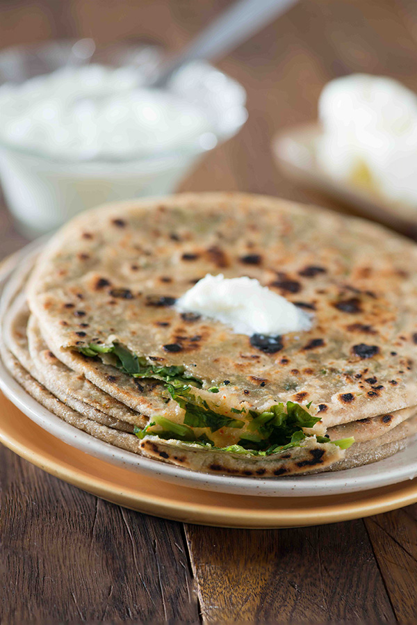 Methi paratha recipe: stuffed methi paratha a crispy paratha stuffed with flavourful fresh leaves of methi. You can serve it for breakfast with curd or with dal or sabzi for a delicious winter meal.