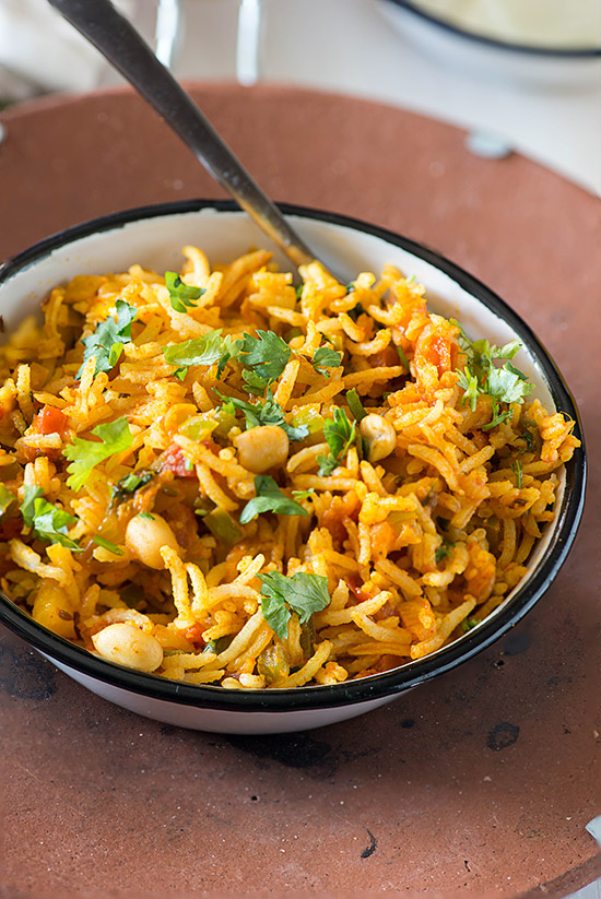 Vegetable Fried rice a great vegetarian rice dish to use up the leftovers. It's a Vegan Glutenfree and tastes exceptionally good because it is extra spicy veggie fried rice. You know I am a rice lover, in fact, I love rice more than I love Roti or paratha, now if only I could eat it for every meal! But me being me whenever I make it I make sure that it tastes absolutely smashing and totally worth of cheating my LOW GI everyday diet. So I go for the recipes that are full of flavors spices and above all try to bring in healthy as much as possible.