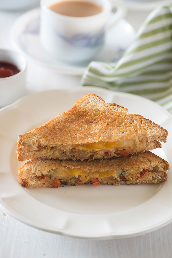 Crispy, buttery hot Capsicum Masala cheese grilled sandwich on a rainy day or a wintery evening, is almost perfect sort of evening snack idea for me or dinner if I just skip the chai, and replace that with hot and steaming bowl of homemade tomato soup.