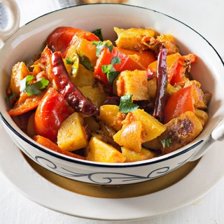 Aloo Shimla mirch sabzi is a simple North Indian sabzi. This recipe of making Aloo Shimla mirch is Punjabi style in which it is cooked with onion and tomato masala. Some dishes are super simple but still taste absolutely fantastic. Aloo Shimla mirch Sabzi is among one of these. There is few variation of this spicy dry curry, Some cook aloo shimla mirch without Onion and garlic with just a few spices which is dry Aloo Shimla mirch.