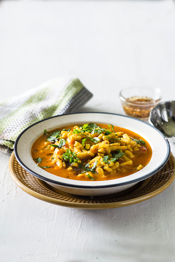 Rajasthani Sev Tamatar Sabzi is spicy sabzi from Rajasthani cuisine. It is cooked with tomatoes and besan sev with spices and is served with Bajra roti