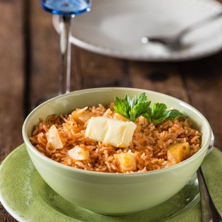How to make Spanish Rice recipe. Spanish rice is actually a mexican dish. Rice is cooked with tomatoes, chili paste that gives beautiful red color to spanish rice