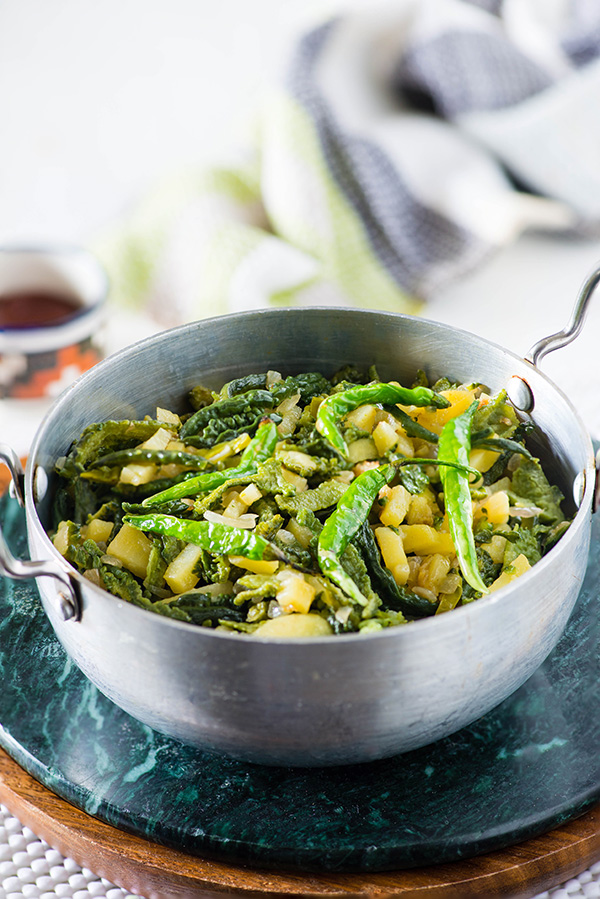 Karele ke chiche ki sabzi, as the name suggest is dry sabzi that is cooked using peels of Karela or bitter melon/bitter gourd. Here's recipe of making this dry sabzi/curry.