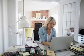 Image of a woman working on her personal t1 ax forms for Revenue Canada.