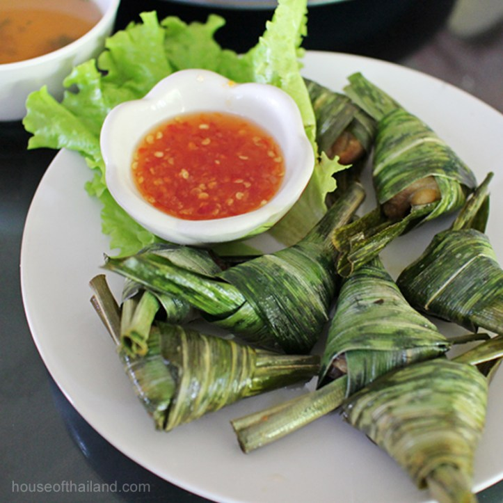 Chicken wrapped in pandan leaves.