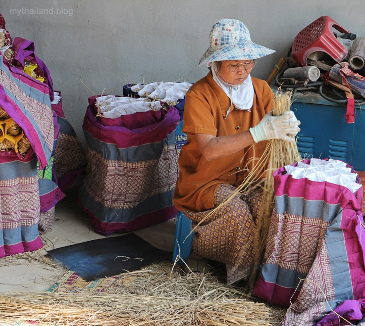 Thai pillow worker making triangle pillows