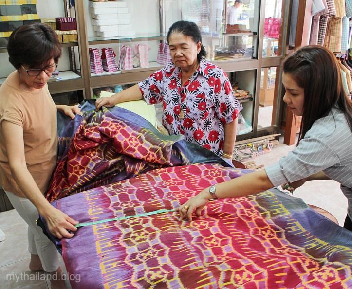 Shopping for mudmee Thai silk in Chonobot, Thailand