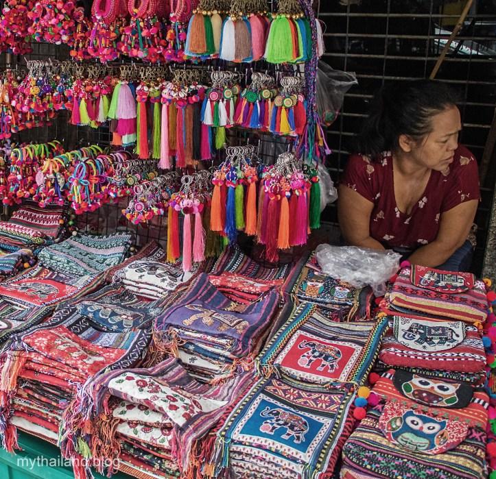 Sidewalk vendor displaying her merchandise in Chiang Mai