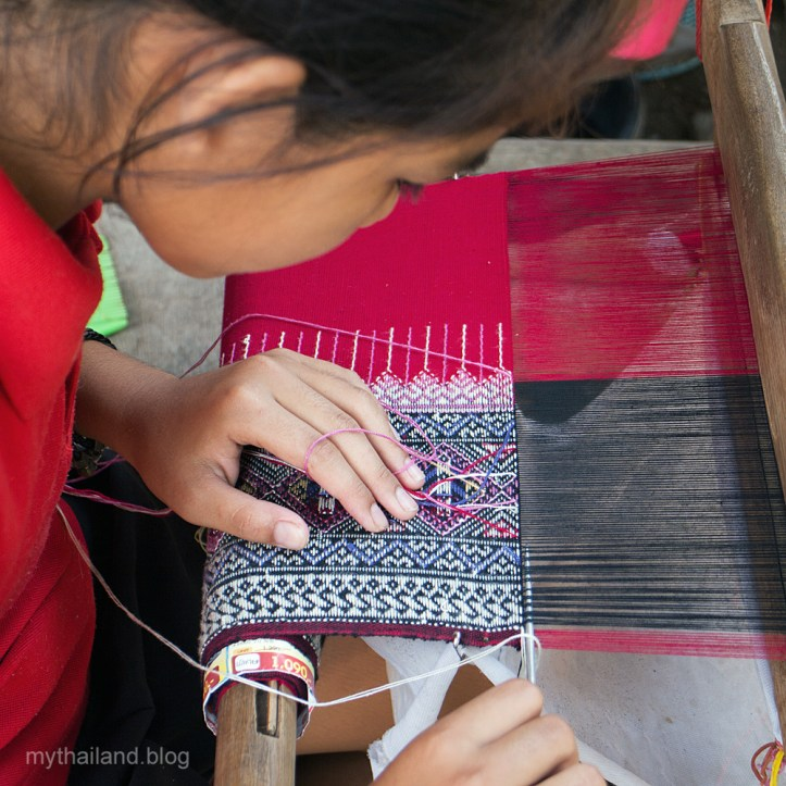 Weaving a teen jok in Thailand