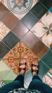 2016-01-24 (1) Michaela, her feet, and sandals on Mantra's colorful tile.