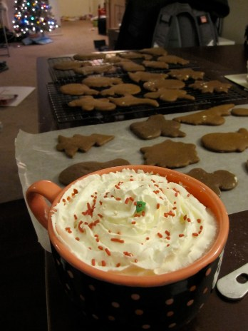 Christmas Eve activities... That is peppermint whipped cream on top of chocolate whipped cream on my coffee... Yum!